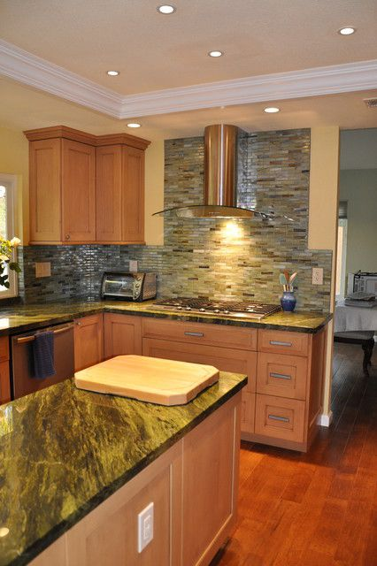 example of a reddish floor with maple cabinets ... on Modern Kitchen Backsplash With Maple Cabinets  id=85187