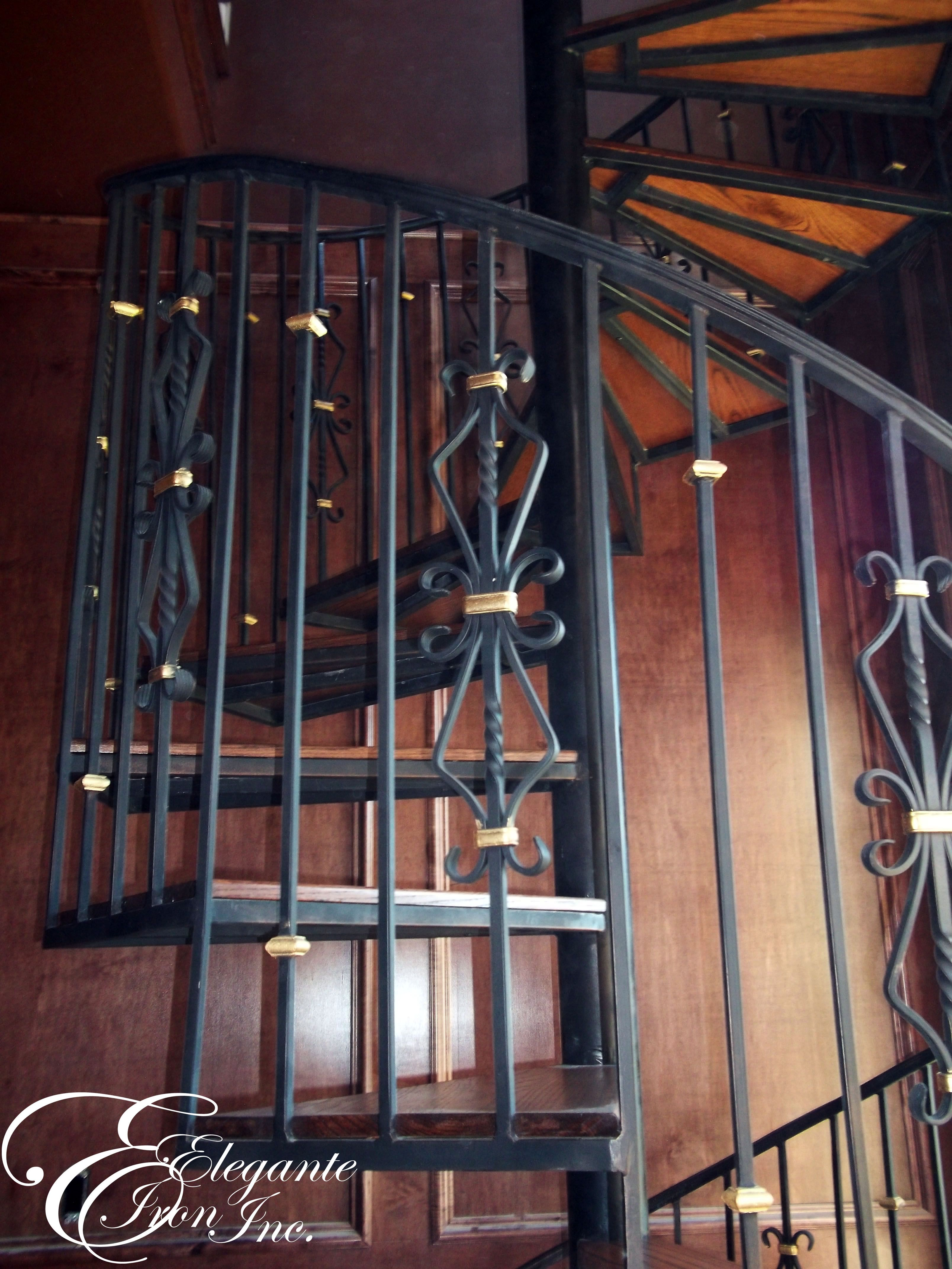 Best Custom Wrought Iron Spiral Stair With Gold Details 400 x 300