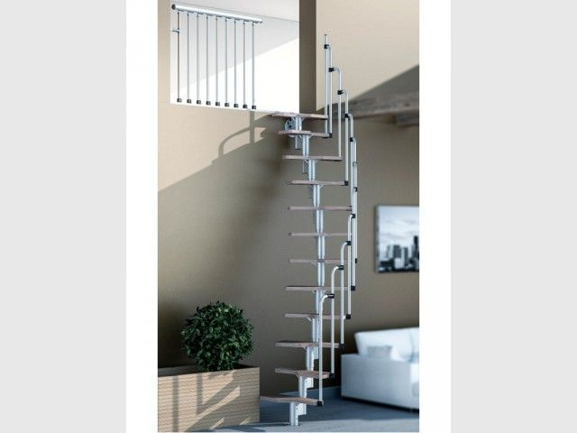 Un Escalier Courbe Dans Un Salon Escalier Gain De Place Escalier Gain De Place Escalier Idees Escalier