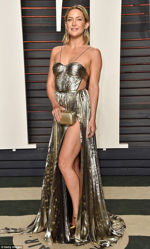 557c575b014 Silver siren  Kate Hudson looked sensational in a metallic gown with a  risqué side split as she arrived at the 2016 Vanity Fair Oscar Party at the  Wallis ...
