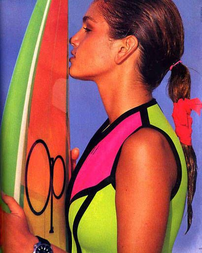 ELLE used to fill their January issues with multiple swimwear stories, and here, a young Cindy Crawford epitomizes late `80s/almost-`90s beach style with a fresh face and neon surf gear from Op and Body Glove (January) - ELLE.com