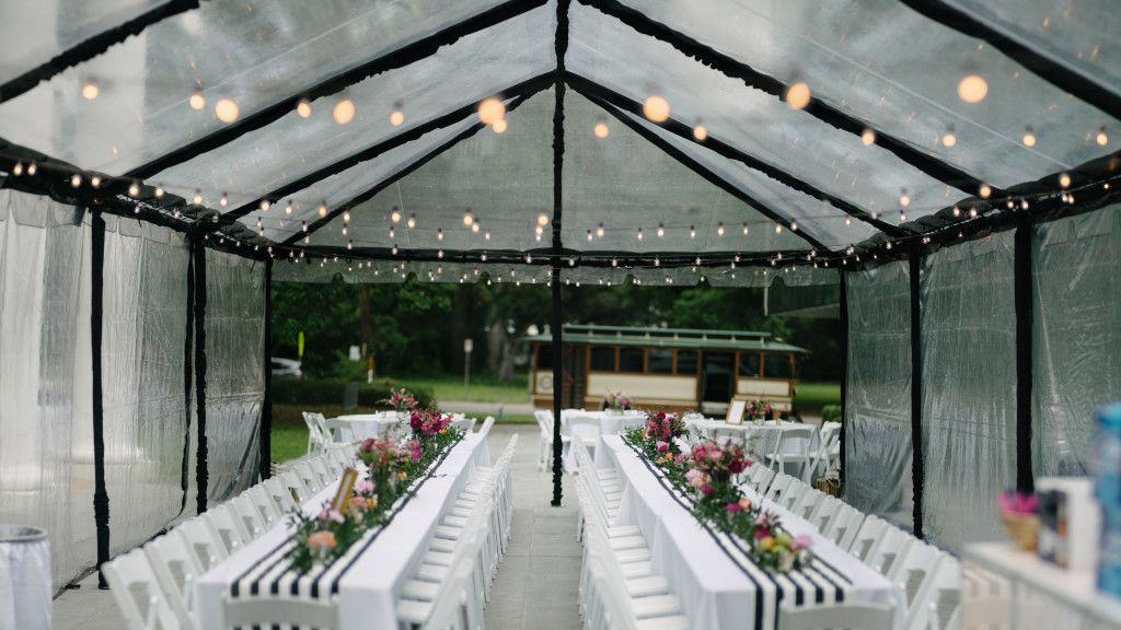 Clear tent with sidewalls black pole covers and festoon for Wedding dress rental baton rouge
