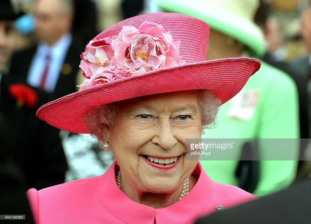 Queen Elizabeth II talks to members of the Household Cavalry during a special Garden Party for the Regiment at Buckingham Palace on May 28, 2014 in London, Untied Kingdom. (Photo by John Stillwell - WPA Pool Getty Images)