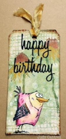 I used stamps, stencils and supplies by Ranger Ink and Tim Holtz on this tag.
