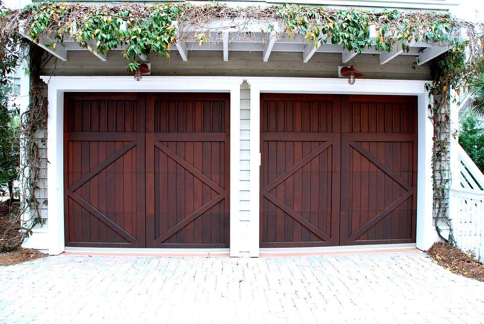 How To Fix Garage Door Panels Garage Door Spring Replacement Garage Door Springs Contemporary Garage Doors