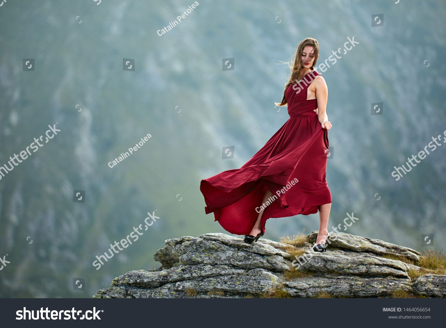 Beautiful female fashion model in red dress on mountain rocks #Sponsored , #affiliate, #fashion#model#Beautiful#female