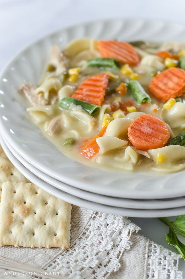 Make this easy Creamy Chicken Noodle Soup with vegetables for supper tonight!  Find the slow cooker recipe at www.andersonandgrant.com #NationalChickenNoodleSoupDay