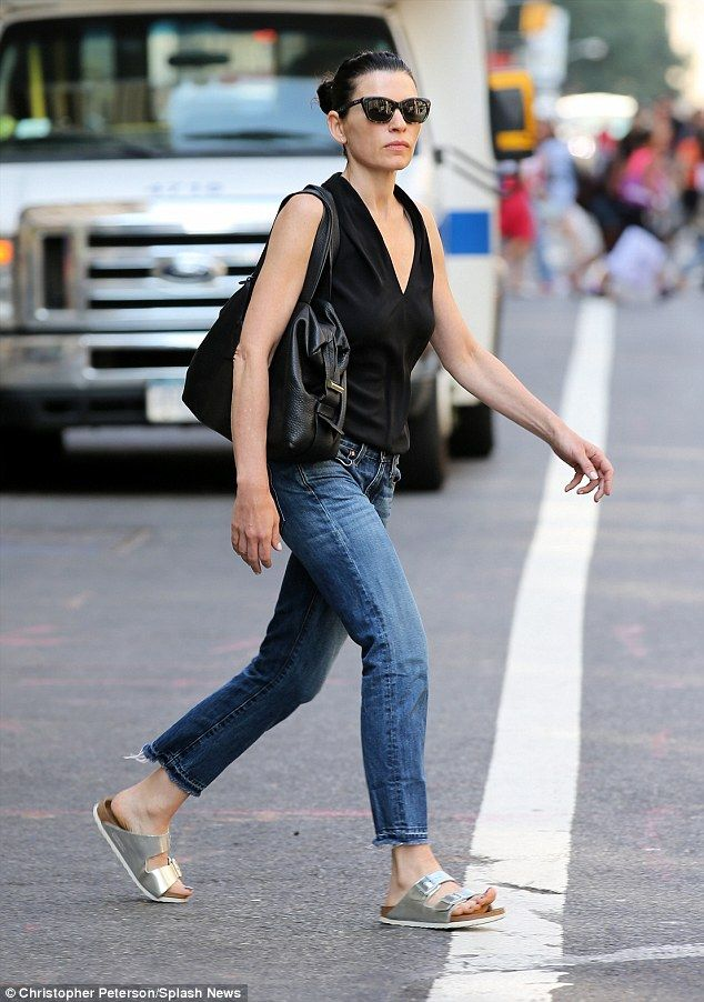 59a6c2531b03 Laid-back chic  The former ER star teamed her simple ensemble of top and  jeans with a pair of silver Birkenstocks and some sunglasses