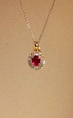 Ruby and diamond double halo pendant in 18k gold $4,595