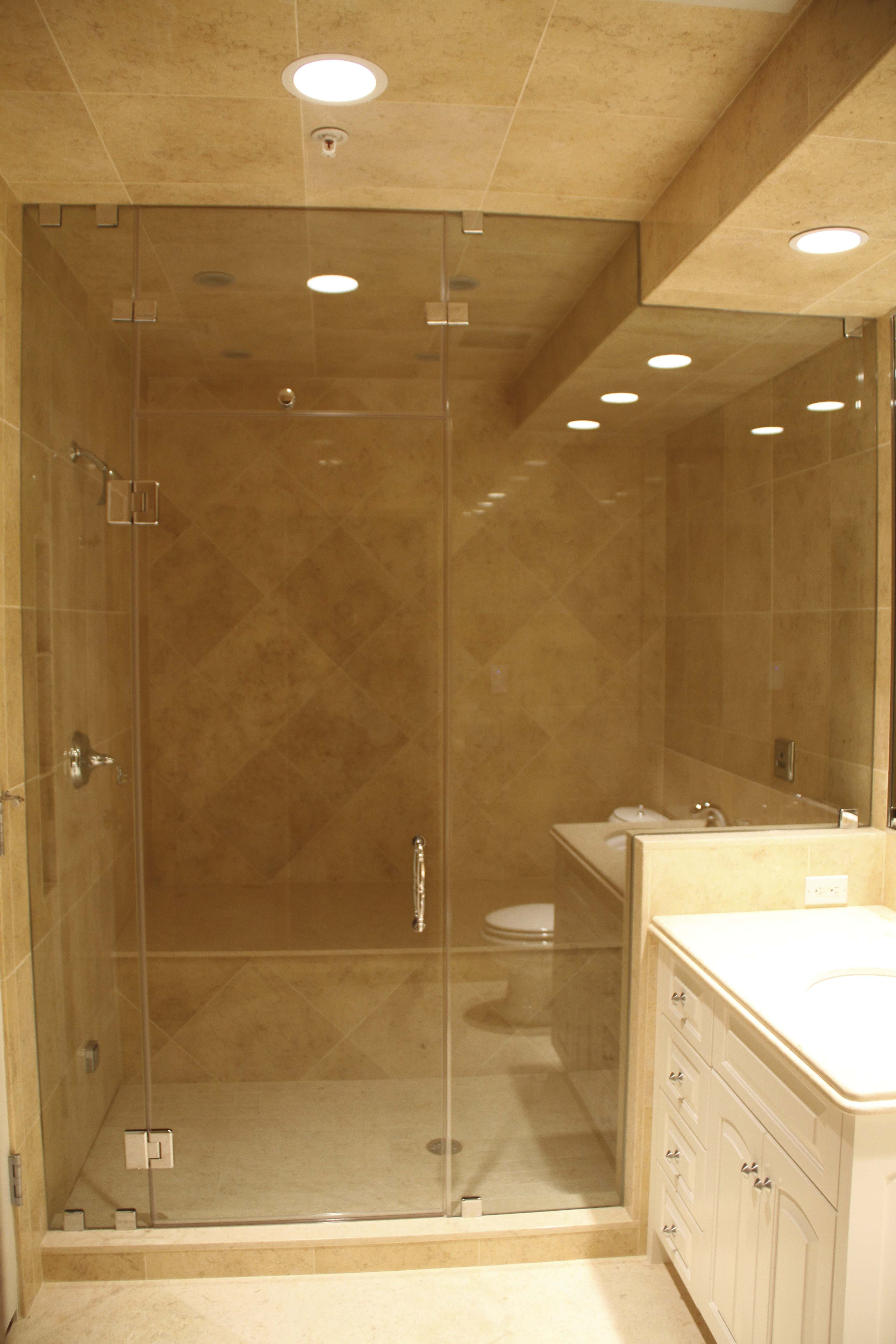 Frameless Shower Enclosure Steam Unit With Venting Transom Above The Door Hinged Glass