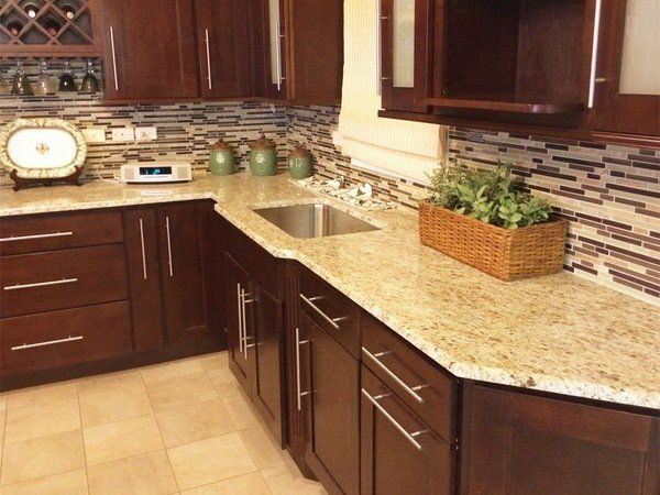 Best Giallo Oremental Countertop Brown Cabinets Tile Flooring 400 x 300