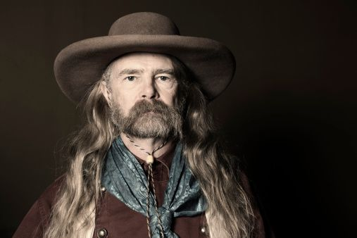 Portrait Of Man With Long Hair Wearing Cowboy Hat Long Hair Styles Men Cowboy Outfits Cowboy Hats