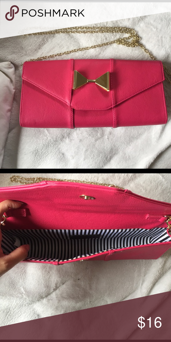 NWOT hot pink clutch with cute gold bow detail NWOT hot pink clutch with cute gold bow detail. Chain strap is detachable Bags Clutches & Wristlets