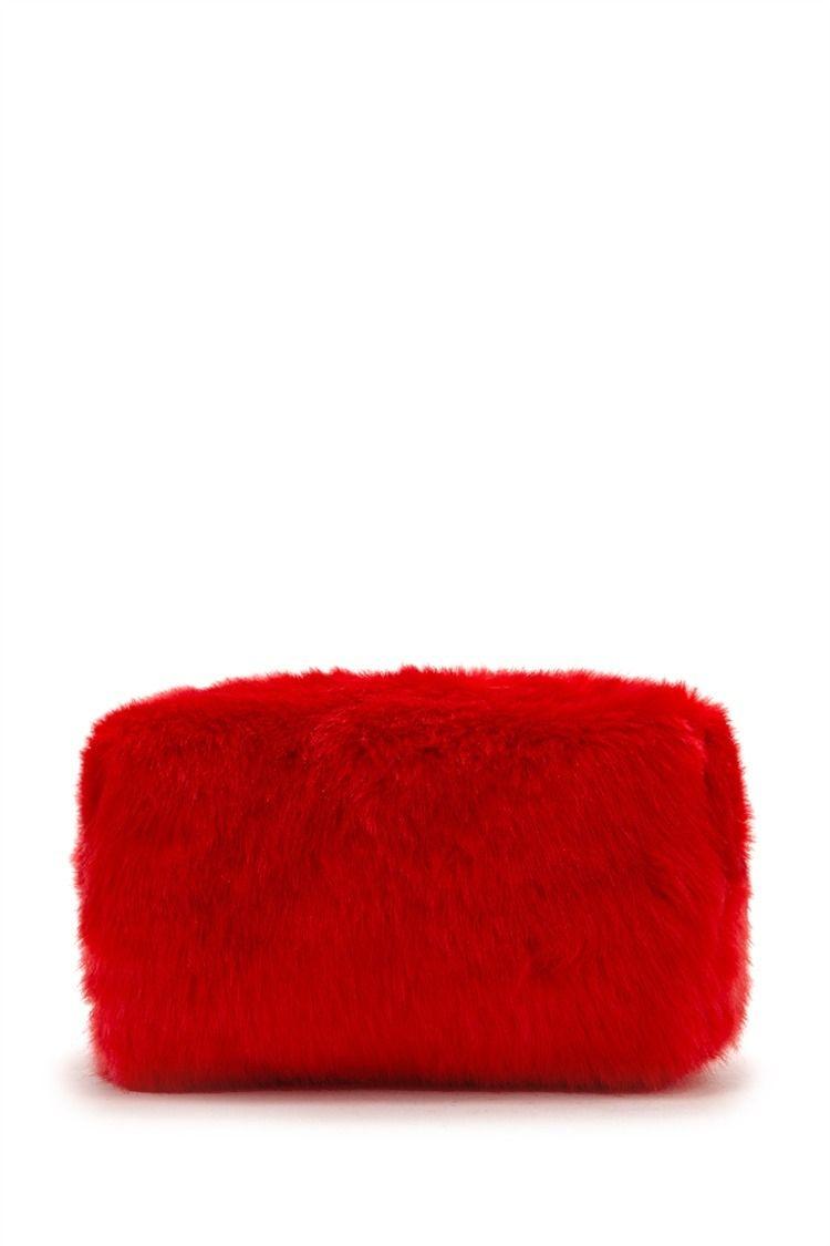 A fuzzy faux fur makeup bag complete with a high-polish zipper top ... cc9954af15