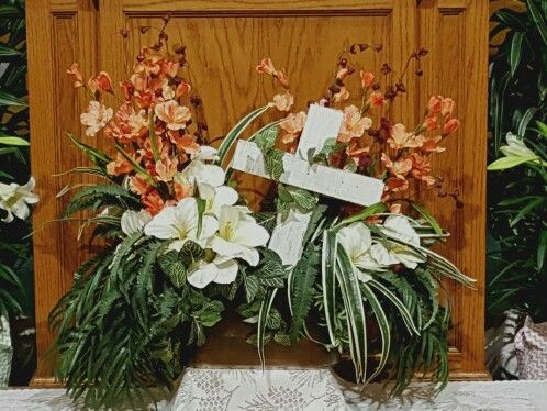 Church easter centerpiece with rugged wooden cross