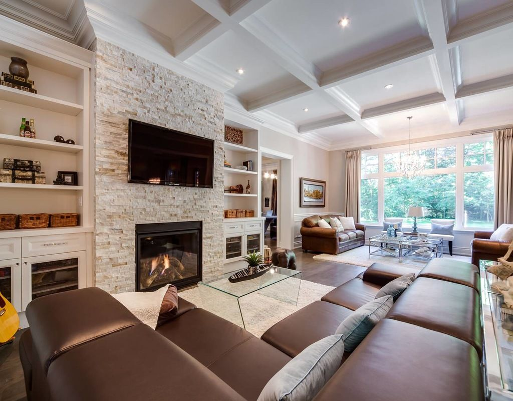 great room furniture placement. Beige Wall Brown Leather Sofa Bookshelf Built In Cabinets Custom Glass Coffee Table Great Room Guitar Stacked Stone Fireplace Tray Waffle Mounted TV White Furniture Placement G