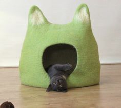Photo of Cat bed. Cat cave house from wool in chartreuse green with natural white
