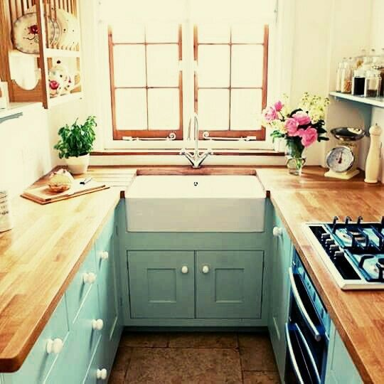 Fresh horseshoe small kitchen layout with aqua cabinets and wood countertops via House… For Your House - Review small kitchen renovations Trending