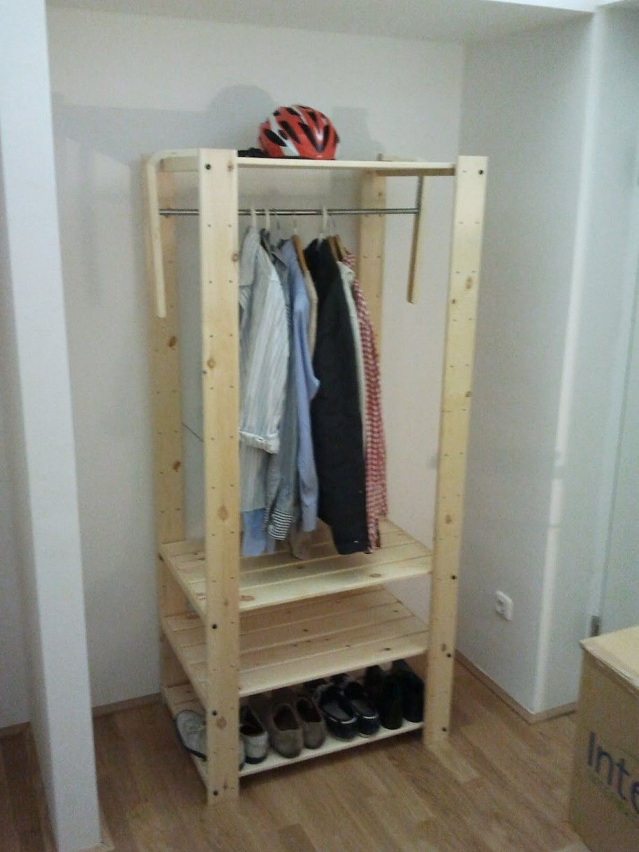 Charming and Useful Temporary Wardrobe Storage: Cool And Useful Wooden Temporary Wardrobe Storage For Men Apparels Like Shirt Shoes Bycicle Helmet Laminate Floor White Wall Paint Color ~ iamsaul.com Furniture Inspiration