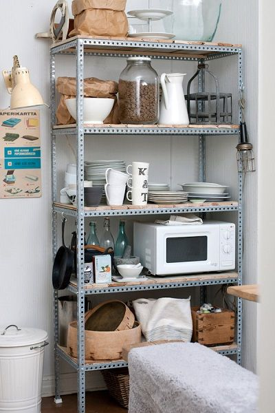 Metal Shelf Unit With Wood Shelves Used For Liances Dishware And Pantry Storage In A Small Or Temporary Makeshift Kitchen E