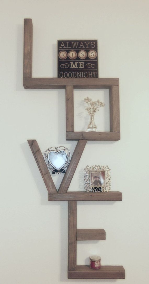 Very unique shelf that spells out the word LOVE. Very impressive size with  many shelf