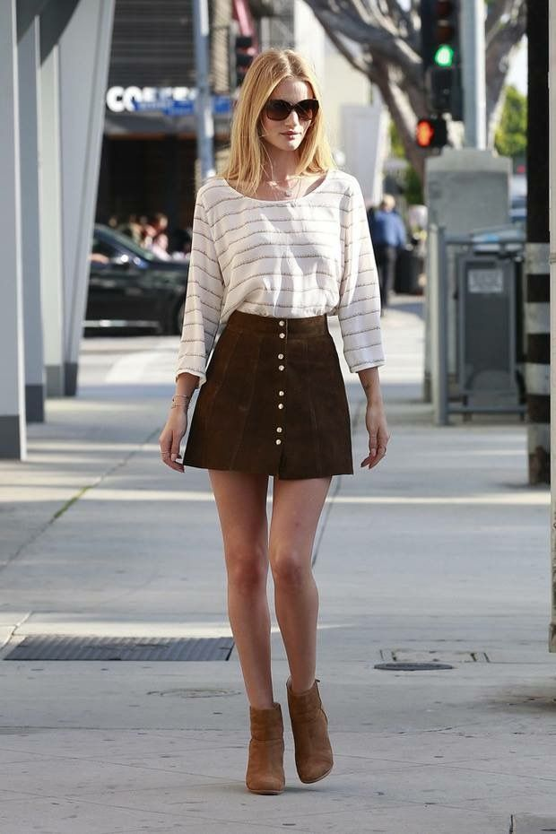 9a97cec217 Rosie Huntington-Whiteley looks effortlessly chic in a white striped top, A-line  suede skirt and cognac ankle booties. i charles green 1452 leestown rd apt  ...