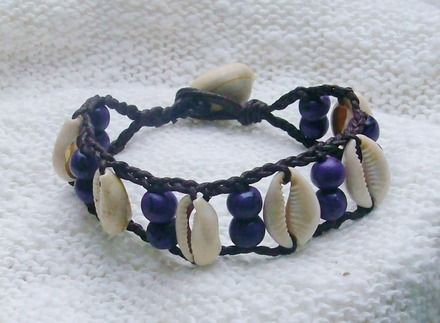Cowry shell bracelet with polymer clay hand rolled beads on braided cotton thread
