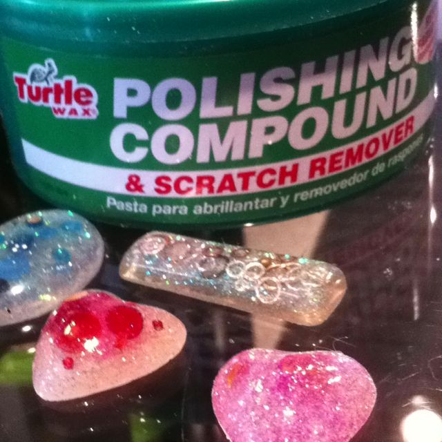 Easy, low-cost solution to shiny, scratch-resistant cast resin jewelry. Turtle wax. Apply a small amount with a Q-tip & buff. Quickly wipe off excess. It's fast, too. Apply after cutting, sanding & buffing. Follow package directions!