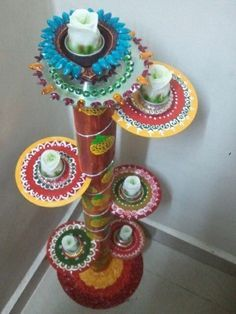 Diya stand from paper roll n waste cd diwali decoration for Best out of waste ideas for class 12