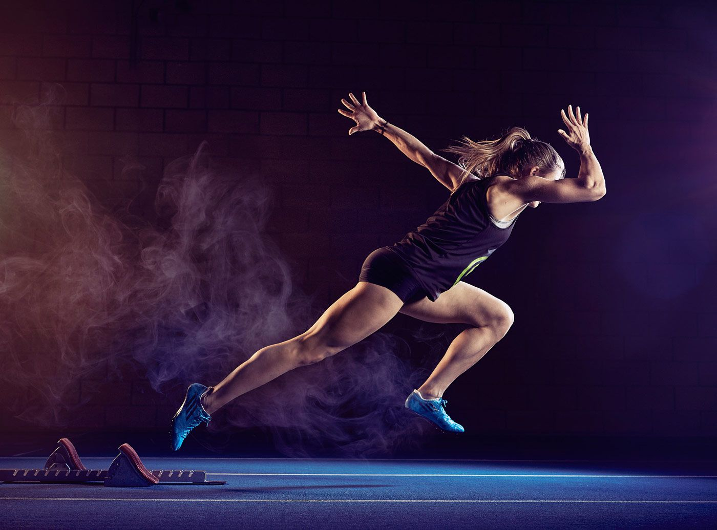 A Female Sprinter Launching Out Of The Blocks Female Sprinter Running Photography Track Senior Pictures