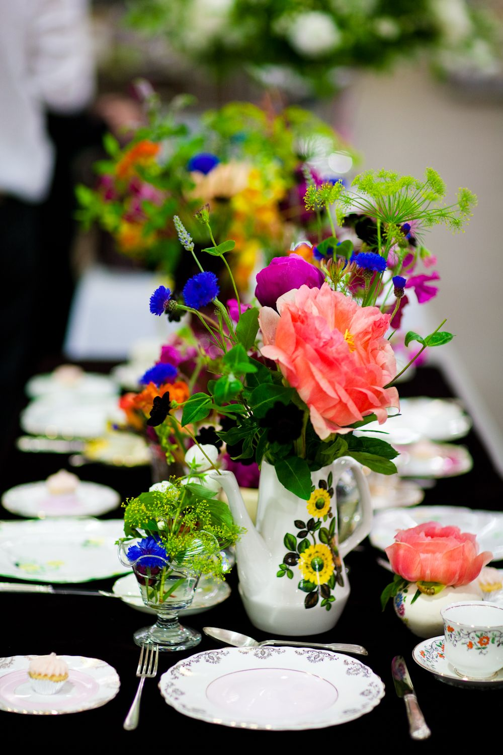 Using teapots for vases ... perfect for a summer wedding. New Covent ...