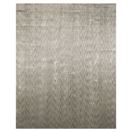 Anchor your living room seating group or define space in the den with this hand-loomed art silk rug, featuring a tonal motif for subtle style.