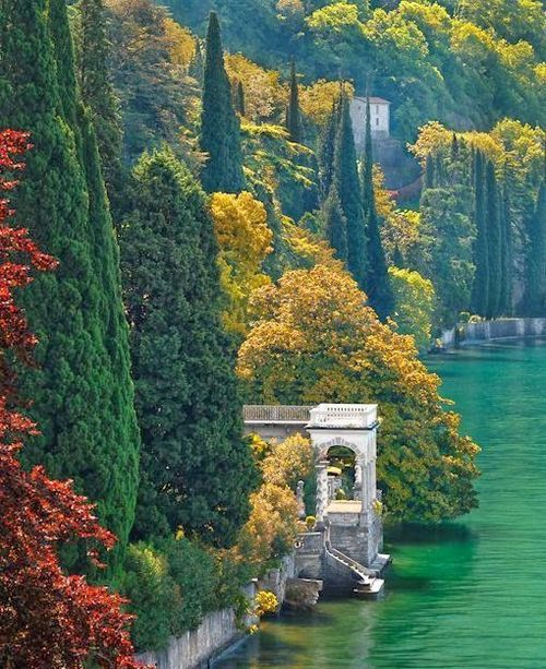 SEASONAL – AUTUMN – the shoreline of lake como during the color of fall in…
