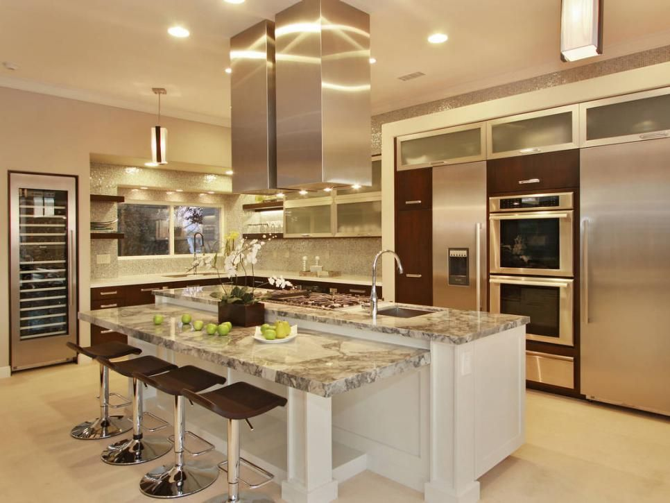 Bon Chrome Kitchen Marble Countertops, Stainless Steel Appliances And A Set Of  Square Hood Vents Above