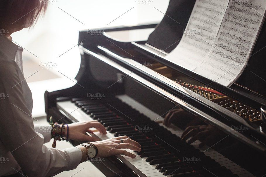 Woman playing a piano by WavebreakPremium on @creativemarket