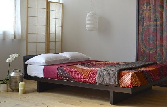 Brown Wooden Plat Form Bed With Short Headboard Combined With