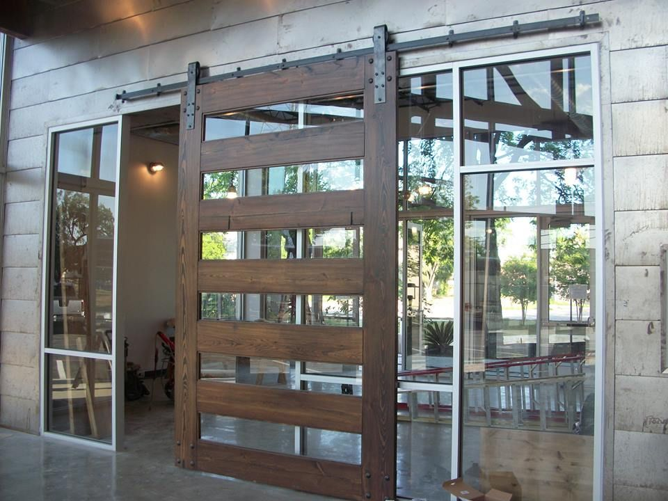 This 7 Wide By 10 Tall Custom Made Wood Barn Door Is In This Atrium Lobby Of Our Current Office Project We Used Th Glass Barn Doors Barn Door Wood Barn
