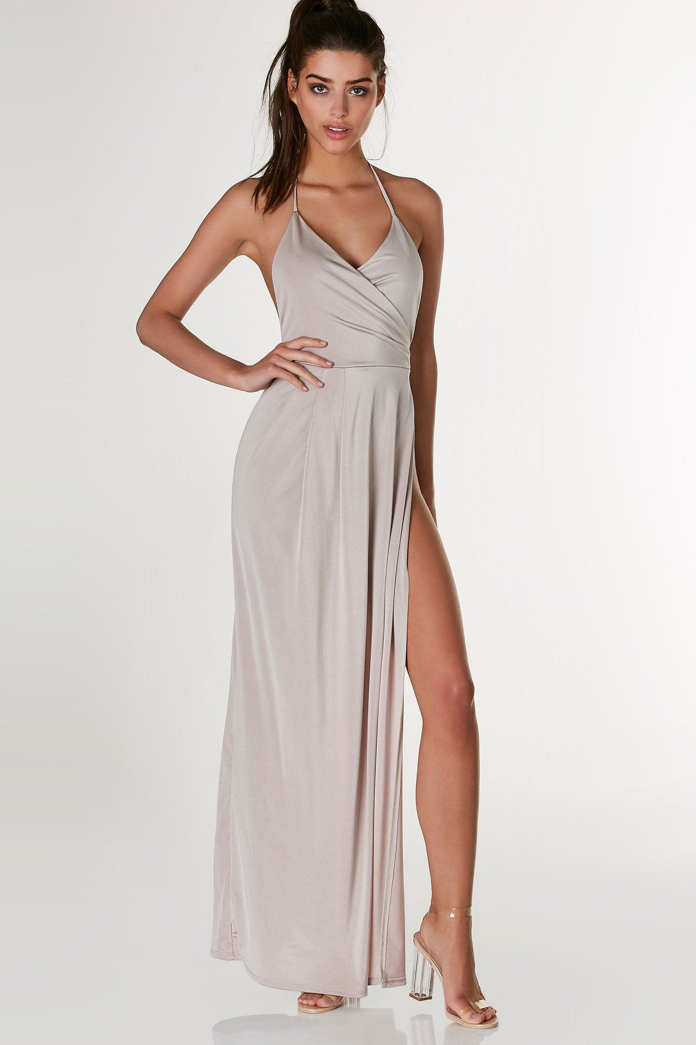 1da3afc1cd Stunning halter maxi dress with overlap neckline and sexy open back. Wrap  style design with bold open side.
