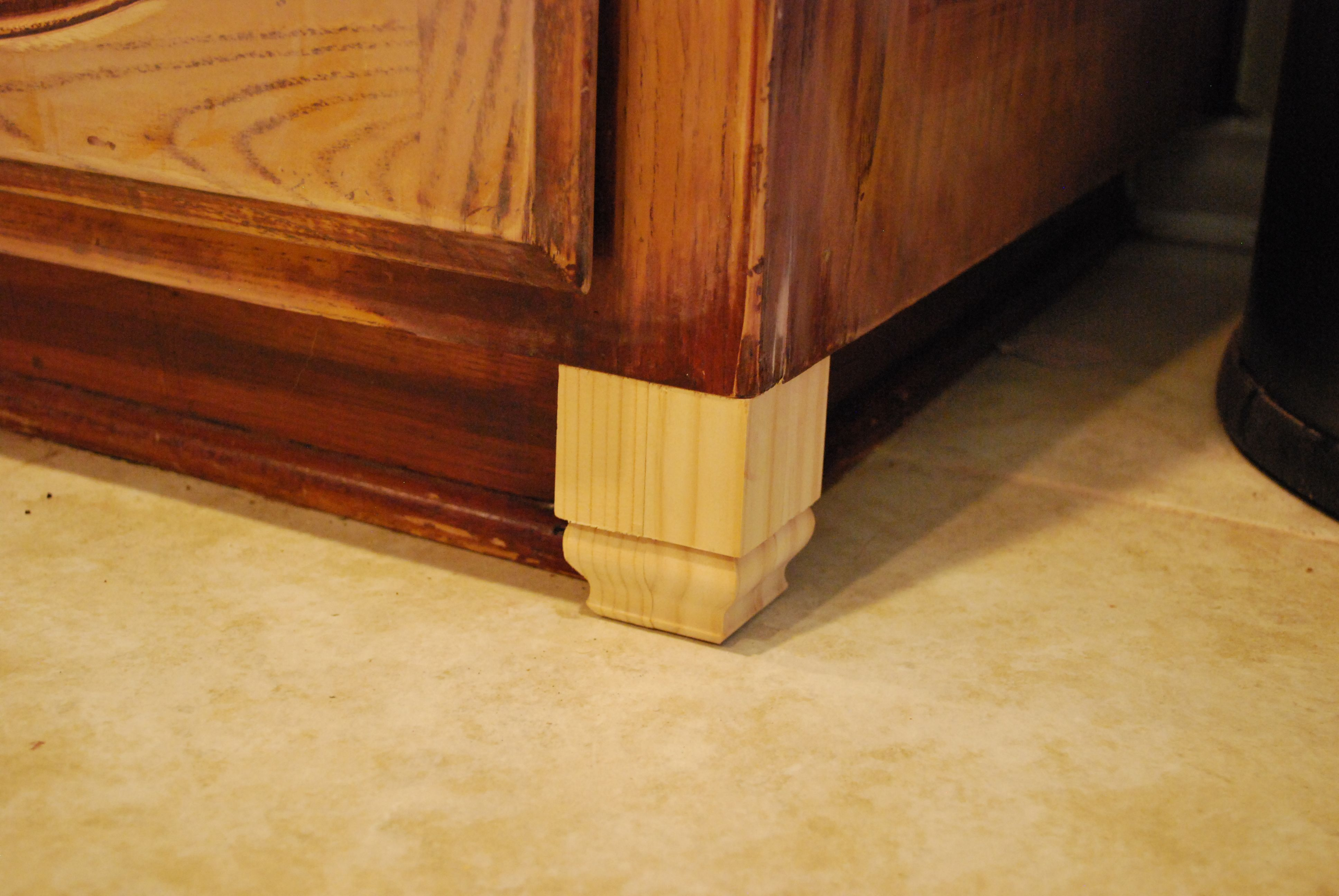 Cabinet feet made from base molding pieces from Home Depot