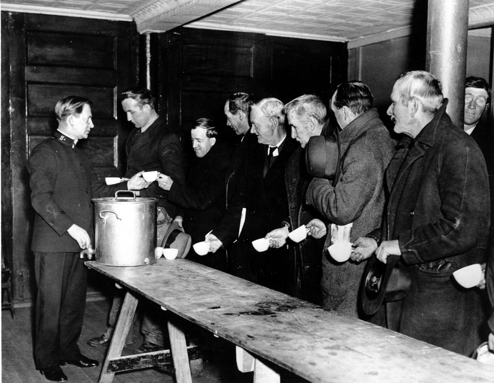 A Salvation Army relief worker tends to a line at a soup ...