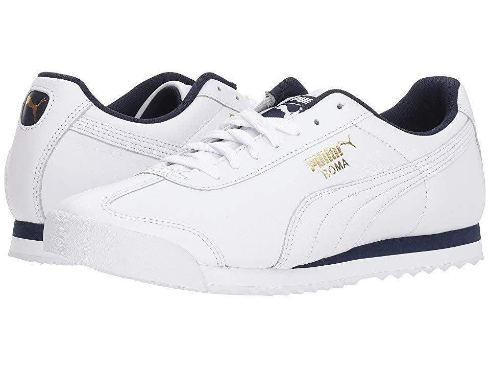 PUMA Roma Classic (PUMA White/Peacoat) Men's Lace up casual Shoes. Lose those workweek dress shoes and throw on these cool and laid back Roma sneakers from PUMA. Smooth leather upper with a round t-toe. Offers a padded tongue and collar for a comfortable fit. Soft and breathable mesh fabric linings. Traditional lace-up closure for a secure fit. Woven PUMA label on tongue. Classic PUMA Roma gold or silver foil detail on lateral #PUMA #Shoes #ClosedFootwear #Laceupcasual #White