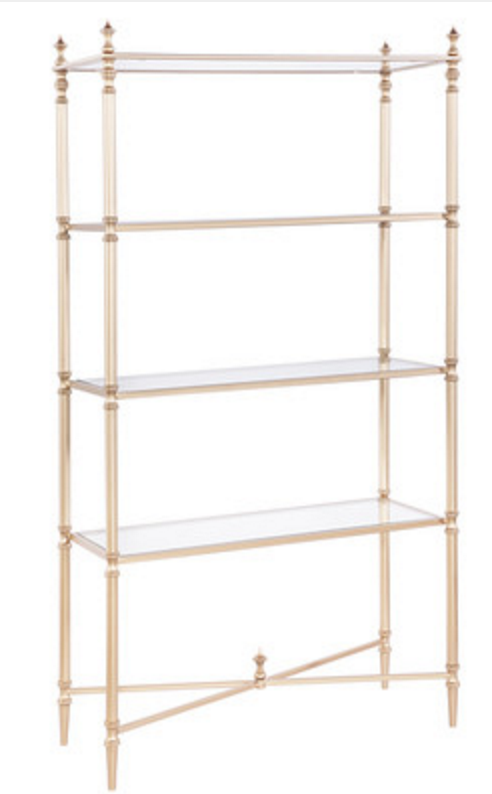 Love this gold shelving unit