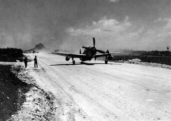 SimonR2800 (@Class91Basher) | Twitter A 318th Fighter Group P-47 taxis out on Le Shima, 1945.