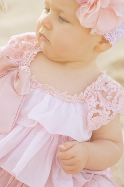 Absolutely gorgeous graduating shades of soft pink voile frills. So comfortable with fasteners at crutch, soft stretch lining. Lace gathered straps which cross