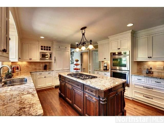 Superb updated kitchen with granite counters and built-in ...