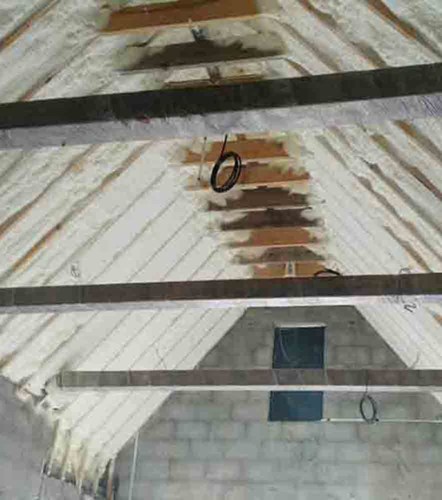 Rafters Being Sprayed With Forma Insulation Foam Insulation Spray Foam Insulation Attic Insulation