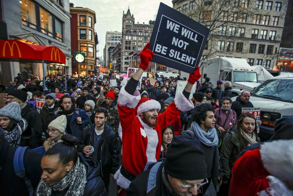 A man dressed as Santa Claus joins protesters in a march against police violence, in Midtown Manhattan, New York. REUTERS/Eduardo Munoz