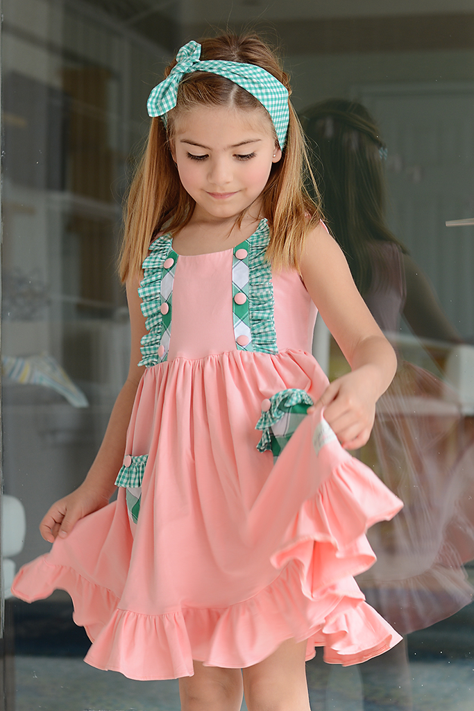This soft dress will brighten up your day with its beautiful coral knit fabric and its hints of green plaid throughout the dress. The dress is made to twirl, so make sure to pick up a pair of our unde