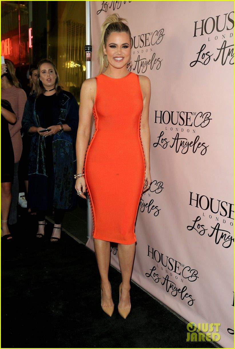 Khloe Kardashian Glows In Orange At House Of Cb Launch Photo Flashes A Warm Smile As She Arrives On The Red Carpet