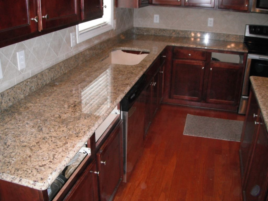 Pin On Granite Red Wood Cabinets